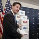 House Speaker Paul Ryan pointing to boxes of petitions supporting a tax-reform bill