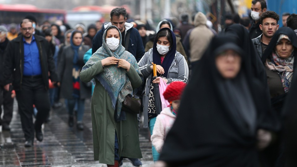 People in Iran wearing face masks