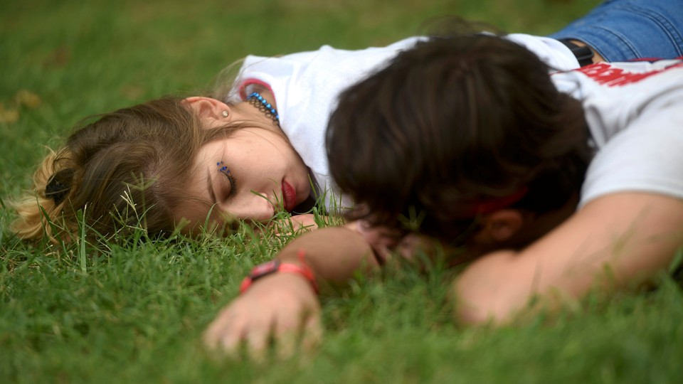 A couple sleeping in the grass