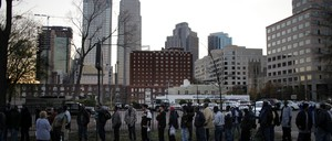 A line of homeless people wait for food in Charlotte