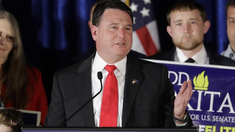 Representative Todd Rokita of Indiana speaking at a lectern
