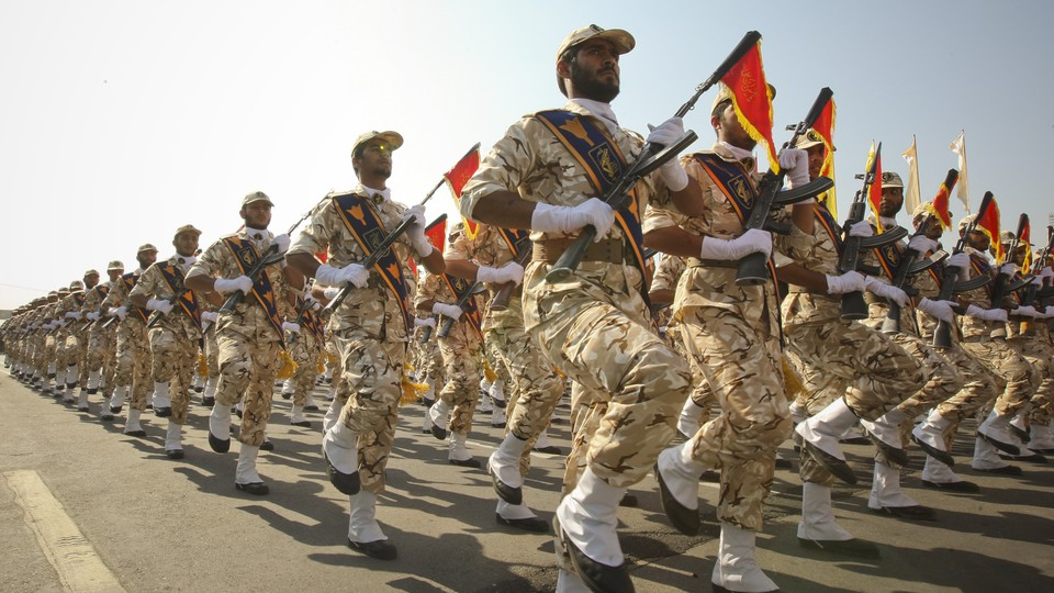 Members of Iran's Islamic Revolutionary Guard Corps march during a commemoration of the Iran-Iraq War in 2011.