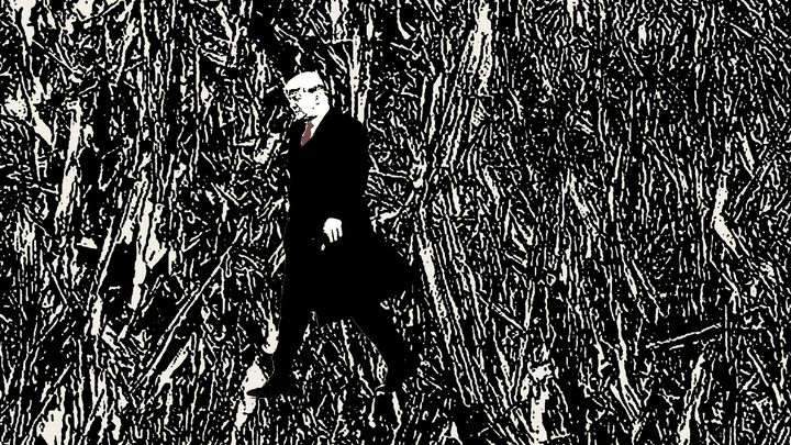 Trump walking before a shattered background
