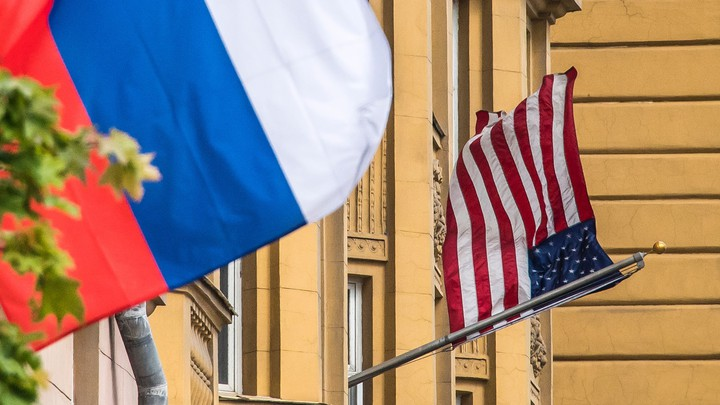A Russian flag flies next to the U.S. embassy in Moscow on July 31, 2017.