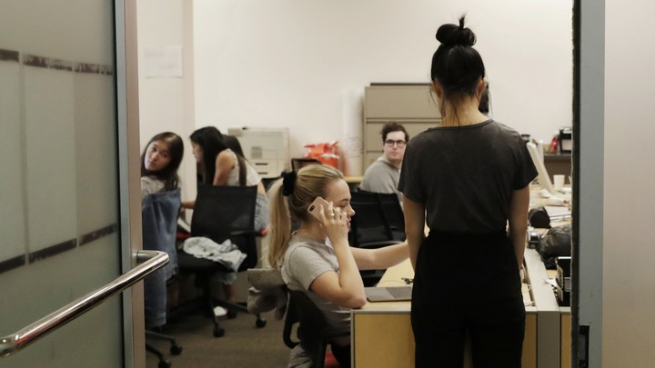 Student journalists in a newsroom