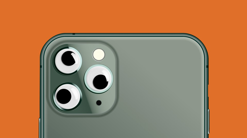 An illustration of a camera phone with googly eyes.