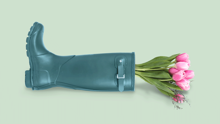 rain boot containing a bouquet of tulips