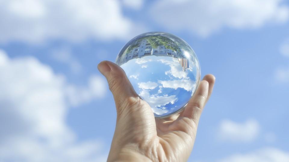 A crystal ball under a pleasant blue sky