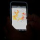 A phone shows a map of Pennsylvania's 17th congressional district