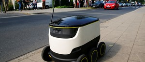 photo: A Starship Technologies commercial delivery robot navigates a sidewalk.
