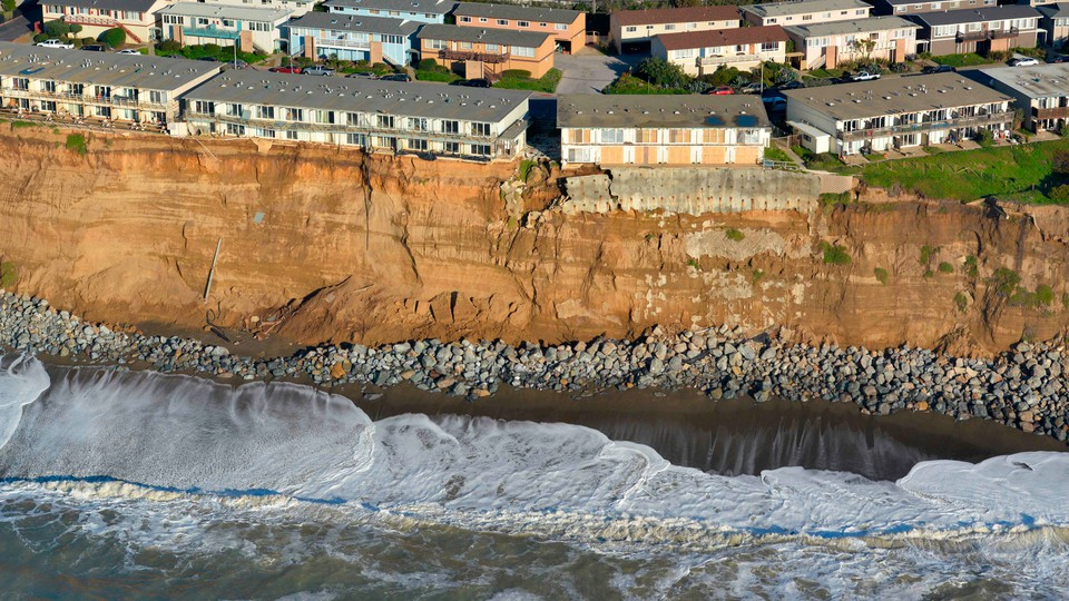 Apartments at the edge of an eroding cliff in Pacifica, California