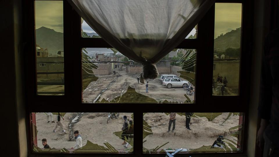 A broken window of a school in Afghanistan