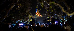 People attend a gathering in support of the members of the dismissed Catalan cabinet regional Parliament in Barcelona.
