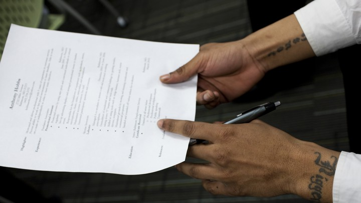 A man recently released from prison held his résumé at a mock job interview during a job-training program at the Center for Urban Families in Baltimore.