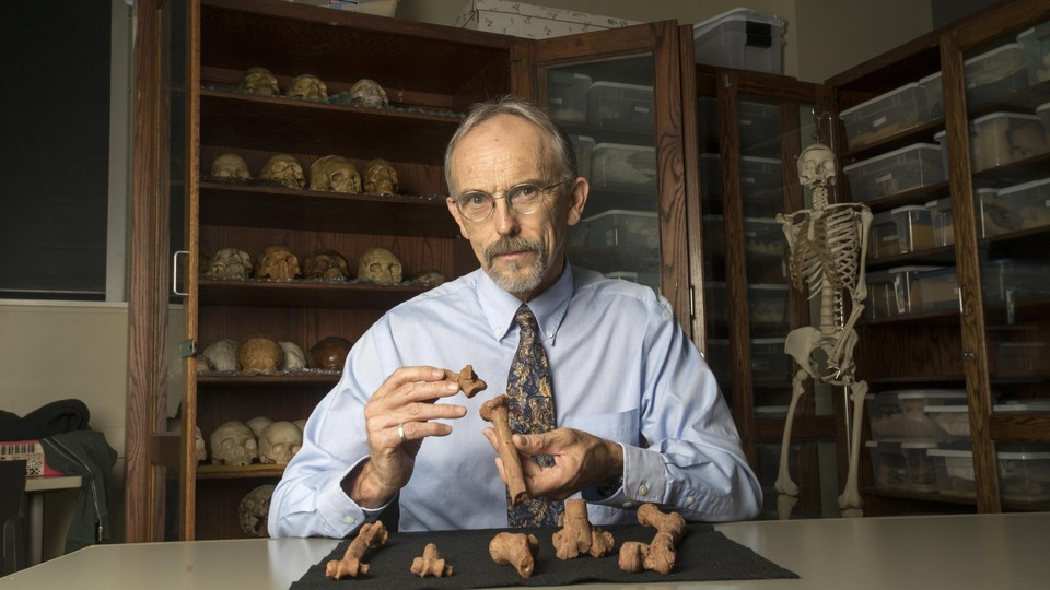 John Kappelman with 3D printouts of Lucy's skeleton