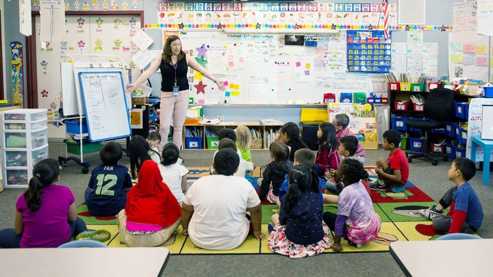 A classroom in bright, blue-rich light.