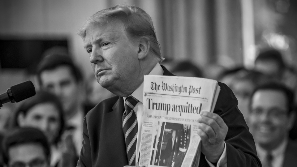 Donald Trump holding up a copy of the Washington Post.
