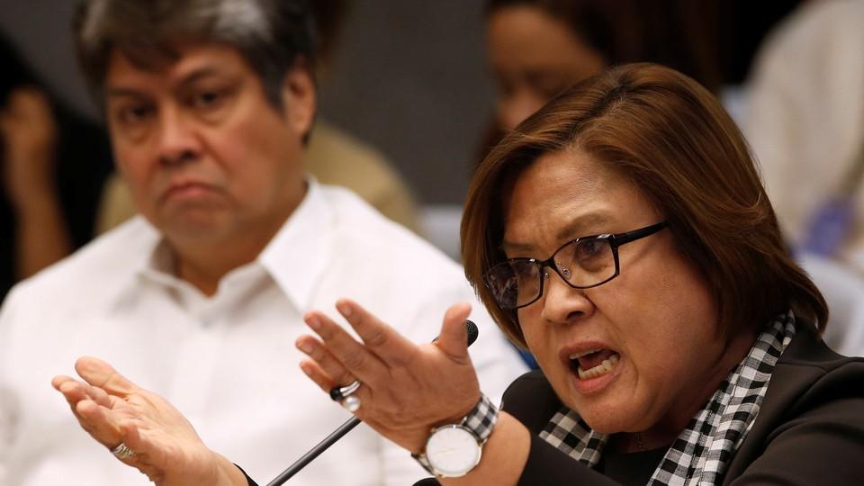 Senator Leila de Lima speaks at a Senate hearing regarding people killed during a crackdown on illegal drugs.
