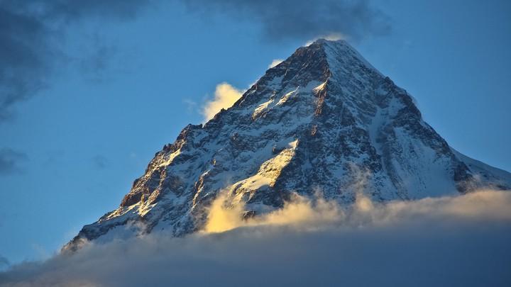 The rocky peak of K2 in the sunlight