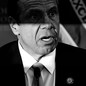 A black and white photo of Andrew Cuomo, looking surprised