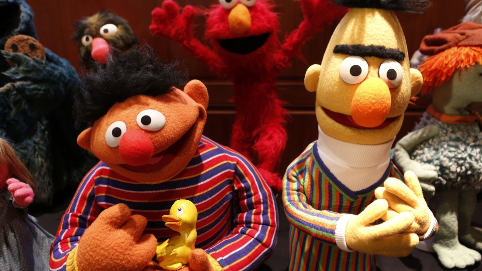 Characters from the Muppets are pictured smiling