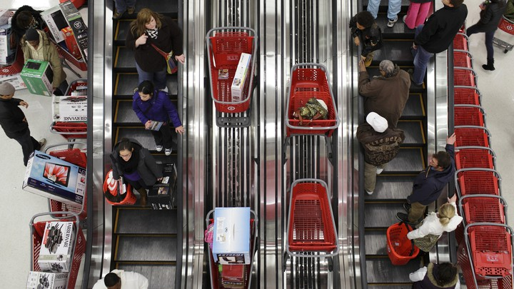 Shoppers ride an escalator in a Target store in Chicago