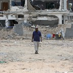A man walks at the site of the October 14 twin bombings in Mogadishu, Somalia, one of the world's most fragile cities.