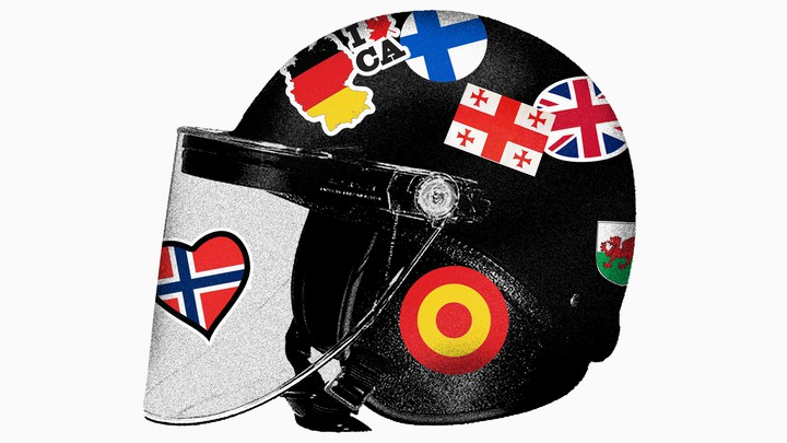 A police helmet adorned with stickers of other countries' flags.