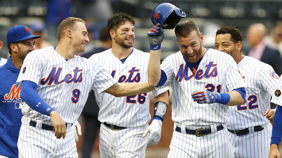 The New York Mets third baseman Todd Frazier celebrates with teammates in a game against the Marlins on September 13, 2018.