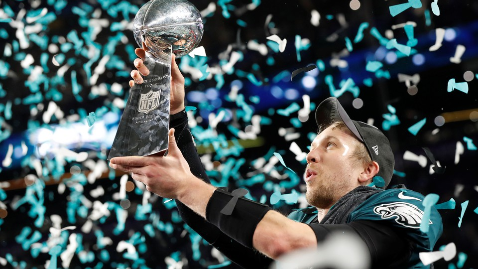 The Philadelphia Eagles' Nick Foles celebrates with the Vince Lombardi Trophy after winning Super Bowl LII