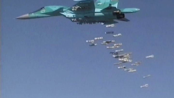 A Russian Sukhoi Su-34 fighter-bomber based at Iran's Hamadan air base, drops bombs in the Syrian province of Deir ez-Zor.