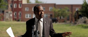 a photo of Housing Secretary Ben Carson in Baltimore in July.
