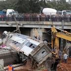 Spectators look at a derailed train at Sidi Bouknadel near Morocco's capital city, Rabat.