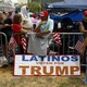 A Latinos Vote For Trump sign outside of a Trump rally.