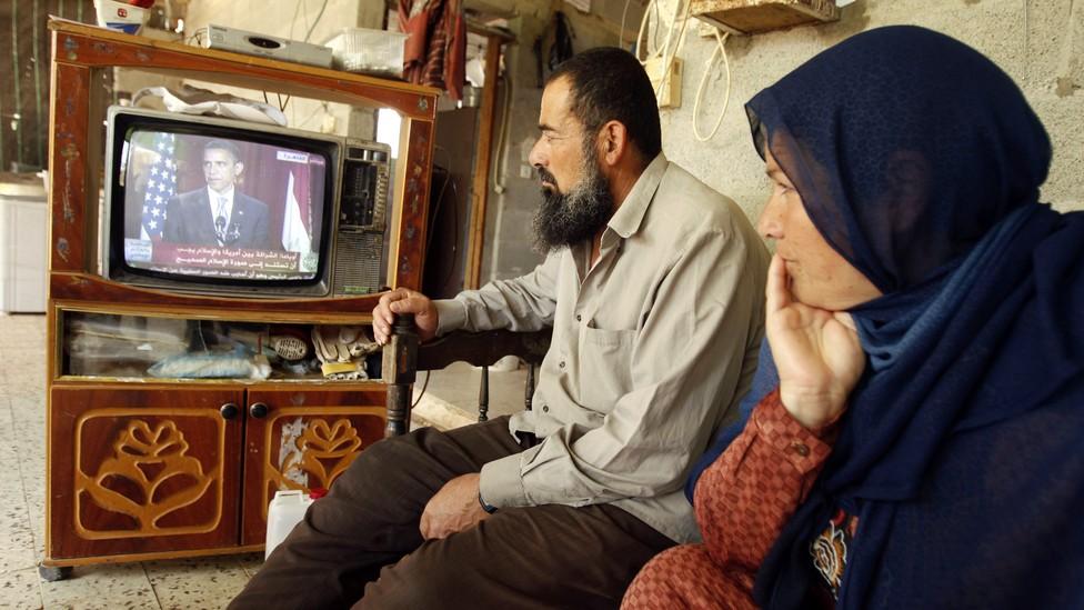 Palestinians in Khan Younis watch Barack Obama speak in Cairo on June 4, 2009.