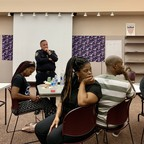 a photo of police and residents of Stockton, CA, in a trust-building workshop