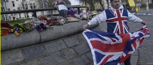 A man holds a British flag after an attack in London
