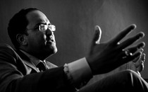 Will Hurd gesticulates in a black-and-white photo.