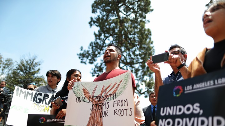 Protesters demonstrate against the termination of DACA.