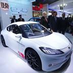 Pawan Goenka, president of India's EV company, Mahindra & Mahindra, displays a new electric sports car in 2014.