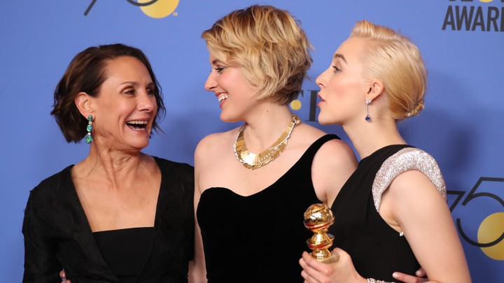 Laurie Metcalf, Greta Gerwig, and Saoirse Ronan pose backstage with their Best Motion Picture: Musical or Comedy award for 'Lady Bird.'.
