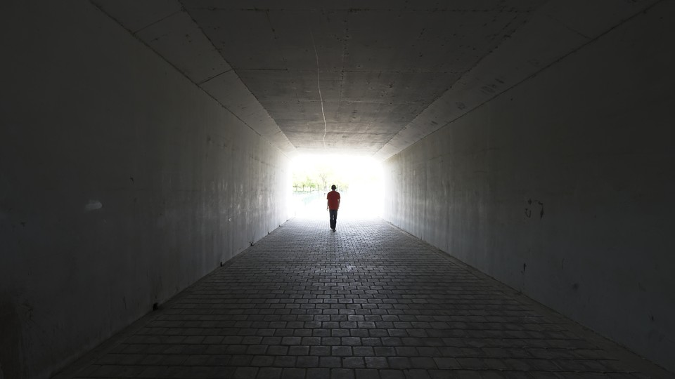 A person walks out of a tunnel