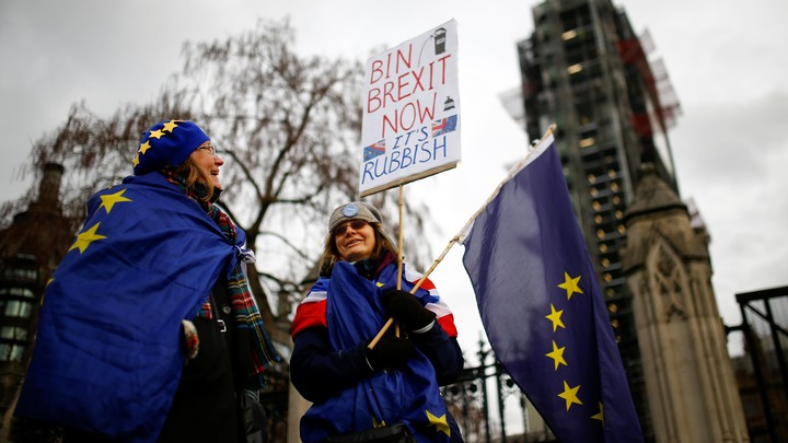 Anti-Brexit protesters are seen outside the Houses of Parliament in London on January 29, 2019.
