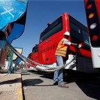 A man charges an electric bus in Santiago, Chile.