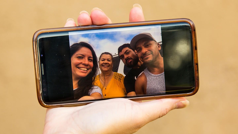 Photo of Christian Zuniga and family on Diana's phone