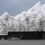 High waves triggered by Typhoon Jebi are seen at a fishing port in western Japan.