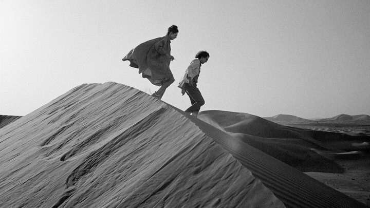 Christo and Jeanne-Claude looking for a possible site for The Mastaba for the United Arab Emirates in February 1982