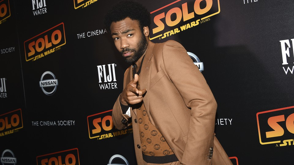 """Donald Glover points at a premiere event for """"Star Wars: Solo."""""""