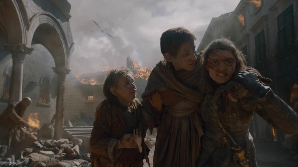 Arya Stark assists innocent victims in King's Landing.