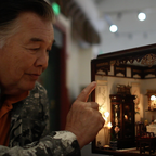 Frank Wong with one of his dioramas of Chinatown